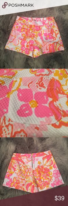"Lilly Pulitzer 0 Alycia Short Resort White Shorts Lilly Pulitzer Alycia Short Resort White ""Happiness Is"" Shorts. Size 0. No stains, tears or wear. 83% Polyester, 16% Cotton, 1% Spandex. These super fun and colorful Lilly Pulitzer shorts feature stretchy basket-weave knit with a bold tropical pattern and are styled with a 3"" inseam, 2 front patch pockets, back 5"" zipper and a clear back button. Style #20799. Lilly Pulitzer Shorts"