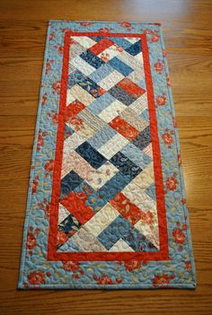 Prairie Paisley Patchwork Tablerunner  Size: 18 1/2 x 41    This tablerunner is a patchwork design of Prairie Paisley fabrics by Polly Minick &