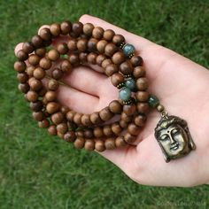 108 Mala Beads, Buddha Pendant, Buddhist Prayer Beads, Meditation Necklace. $37.00, via Etsy.