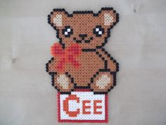 If you are looking for a beautiful and original plate to hang on the door, with your child's name on it, look no further! Made of fuse beads, it can be changed to suit your taste; not only the colour but also the decoration. This listing is for a name with 4 or less letters and a big decoration...