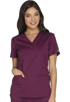 Core Stretch By Cherokee Workwear Women's Mock Wrap Solid Scrub Top X-Small Wine Missy modern classic fit Crossover mock wrap v-neckline Short sleeves Pen or instrument loops at right shoulder Back yoke and center seam Cherokee Woman, Cherokee Scrubs, Scrub Jackets, Medical Uniforms, Womens Scrubs, Medical Scrubs, Scrub Pants, Pull On Pants, Scrub Tops