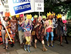 Anarchy! Vivienne Westwood led her Fash Mob in a fake protest for her spring/summer 2016 s...