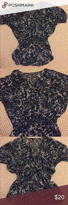 V neck blouse Multi colored v neck w/ sinch waist Express Tops Blouses
