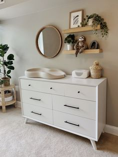 Changing table for gender neutral nursery. Includes the keekaroo peanut changing pad, dresser from All Modern, plants and shelves from Target Baby Boy Rooms, Baby Boy Nurseries, Modern Nurseries, Neutral Nurseries, Baby Bedroom, Nursery Neutral, Baby Nursery Decor, Nursery Ideas, Project Nursery