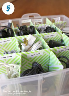 Organize electronic cords using an ornament container. Sure beats the container of random cords we've got going on right now!