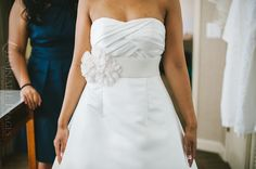 Inexpensive DIY to spice up a wedding gown: A waist belt with floral pin
