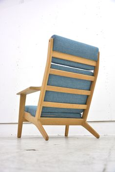 Classic Hans Wegner designed oak high back armchair from GETAMA.  GE290 Classic in new upholstery £1150