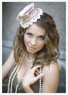tea cup hat and pearls. I want to have a Alice in Wonderland theme party