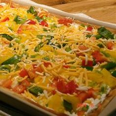 Garden Veggie Pizza Squares- 2 crescent rolls spread in cookie sheet bake till golden, top with cream cheese (softened) mixed with one packet ranch, top with shredded cheese and your choice veggies