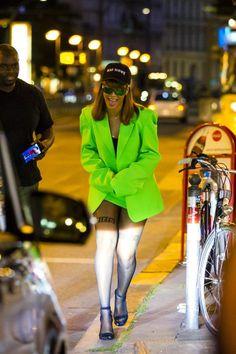 Rihanna wearing Manolo Blahnik Chaos Sandal, Vetements Spring 2016 Jacket & Skirt, Alexander Wang Fall 2016 Sheer Girls Stockings and Rihanna x Dior Shield Sunglasses Green