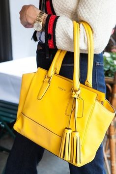 Yellow purse with tassels
