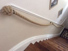 """""""Just wanted to say how delighted we are with our 48mm Synthetic Hemp Stair Rope. The bespoke Blacksmiths Brackets you made are perfect. The whole thing is just beautiful - in fact you have exceeded our expectations and everyone is commenting on how amazing it looks."""" This is 48mm synthetic hemp with stemmed brushed steel forged brackets. Rope Railing, Banisters, Clothes Hanger, Stairs, Coventry, Living Room, Basement Ideas, Bathroom, Hemp"""