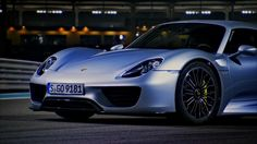 Still in Abu Dhabi, Richard drives the new hybrid sports car from Porsche, the 918, to see if it has what it takes to beat McLaren's hybrid hypercar, the P1....