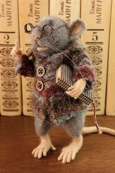 Mr. Mouse  Please be aware that this item is MADE TO ORDER The waiting time is currently 2-3 weeks. This wait period is an estimate and could change at any time, so please contact me if you are concerned about the time frame. Thank you all for your patience!  This is Mr. Mouse. He is very clever, because he read a lot of books. Mr. Mouse wears glasses, warm wool jacket with two buttons and holding a miniature, vintage- looking book. This item will be a great decoration for your house. Looks…