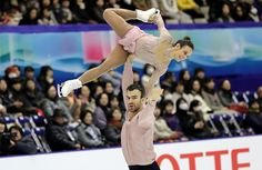 Meagan Duhamel and Eric Radford of Canada won their third consecutive NHK Trophy gold in Sapporo, Japan.