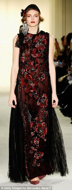 Fantasy fashion: Craig and Chapman explained that the3D organza poppies threaded througho...