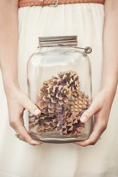 Decorating can't get any easier than a glass jar and pinecones.