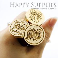 Pretty initial wax seal http://www.etsy.com/listing/154418312/1pcs-25mm-custom-initial-gold-plated-wax