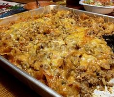 Walking Taco Casserole Brown lbs ground beef chopped onion-Add small can green chilies, 1 can enchilada oz. cream cheese to meat Layer in casserole dish Fritos chips, meat mixture, shredded cheese Repeat layers Bake min till cheese bubbles Casserole Taco, Casserole Dishes, Casserole Recipes, Taco Bake, Mexican Casserole, Walking Taco Casserole Recipe, Casserole Kitchen, Taco Casserole With Tortillas, Spaghetti Casserole