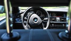 Seattle police officers arrest a 38-year-old man who was remotely locked inside a stolen BMW.