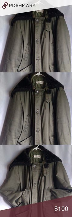 """Parka Heavy Cold Weather Coat Olive Green Details - Vintage Men's Green Parka, hood that unzips to lay flat, two hand warming pockets, two hip flap covered pockets, Quilt like lining. Zip closes hidden but button up closure.  Measures approx: Tag Says - Large Length - 36"""" Chest - 25"""" x 2 = 50"""" Sleeves - 24.5"""" Shoulders -21""""  Item Condition - Pre-Owned Vintage Used Condition. Has a black stain on the left arm. The inside arm pit quilt like material have small holes in it. Parka Jackets…"""