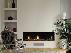 Cheminee on pinterest fireplaces foyers and wood storage for Decoration maison 70m2