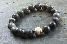 Check out this item in my Etsy shop https://www.etsy.com/listing/88065449/black-labradorite-mens-bracelet-with