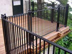 Iron Deck Railing Designs Check out more Deck Railing Ideas http://awoodrailing.com/2014/11/16/100s-of-deck-railing-ideas-designs/