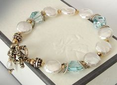 Blue Topaz Bracelet  White Coin Pearls by jQjewelrydesigns on Etsy, $95.00