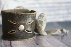 Reused old leather belts make great cuffs.....