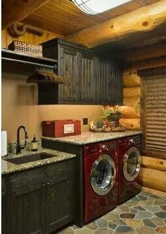 What a perfect laundry room. Love the red appliances, granite counters and the tile is nice as well.