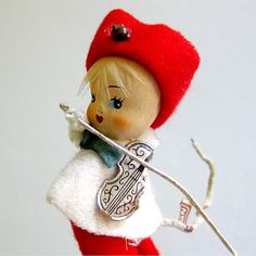 Vintage set of 3 musician Christmas ornaments. Pixie elves are made of red felt and pipe cleaners. Their heads feel like paper mache but could be plastic (composite?). Three-piece band with violin, french horn and symbols. Each measures about 4 tall. They have pipe cleaner tails for affixing to the tree.  SWEET! Thanks for looking!  vintagedame.etsy.com
