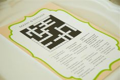such a cute idea! crossword puzzle about the couple at the tables for guests to fill out. forces people to talk ;)