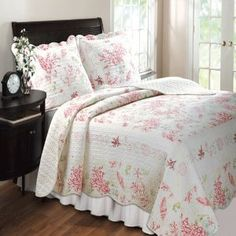 Coral Red Quilt and Sham Set :           The Coral coastal quilt set will dress your room up like a beach bungalow The coral and seashell print is framed with embroidered shells, starfish and seahorses Reverses to a coordinating stripe Vermicelli quilted all-over for durability and oversized for better coverage o...