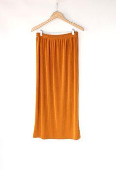 Vintage 80s Metallic Copper Slinky Floor Length Skirt // Long Gold Skirt. $32.00, via Etsy.
