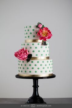 K+B like the fondant ribbon on bottom of each tier.  Three-tiered ivory fondant cake with green Swiss dots and hand-sculptured sugar peonies.