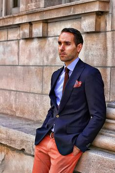 Navy sport coat, white shirt with blue dress stripes, burgundy knit tie, orange pants