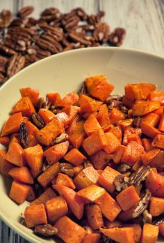 Pecan and Sweet Potato Side Recipe  2 large sweet potatoes, cut into cubes ½ cup extra virgin olive oil 3 tbsp. ghee, cut into small pieces ¼ cup raw honey (optional) ½ cup pecans, cut into pieces ½ to 1 tsp. chili powder Sea salt and freshly ground black pepper