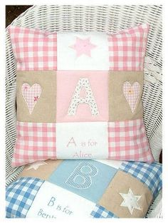 "This beautiful patchwork pink or blue and natural linen cushion appliqued with an initial and embroidered name makes a lovely gift for a new baby, Christening or birthday. Removable cover and feather pad Size 35cm (14"") square. <em><strong>PLEASE NOTE: Our e</strong><strong>stimated delivery time is 14 to 21 days as this product is handmade to order. But if your order is required for a specific date, please let us know when you place your order and we will be pleased to do our best to get it…"