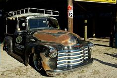 Chev Chevy Chevrolet Advanced Design pickup truck slammed and sporting a ratrod rat rod patina rusty jalopy daily driver finish and a really sweet overhead roof rack ladder rack.