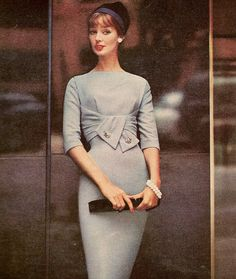 Dolores Hawkins wearing an empire draped wool dress by R & K Originals, hat…