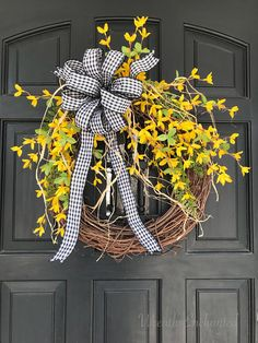 Sweet Forsythia Wreath. Includes 18 in Grapevine Base, Ferns, Yellow Forsythia Florals, Raffia and Black and White Gingham Bow. Great Spring, Easter Decor for Front Door, Entryway, or Wall. Makes Great Housewarming Gift. Measures approx 24 in Round tip to tip.