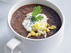 Black Bean Soup | Cut back on calories and cash, without sacrificing any flavors, by cooking some of our favorite creamy soup recipes at home.