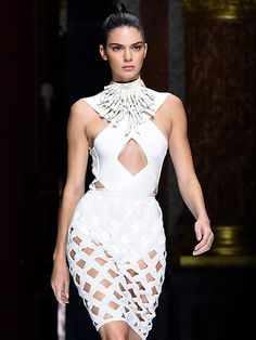 Kendall jenner in a cutout white dress in the Balmain spring 2016 show