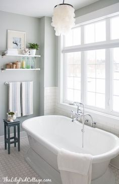 LOVING this grey master bath from @The Lily Pad Cottage. That soaking tub alone makes the space for me, even though I enjoy the color and decor and lighting, too! /ES