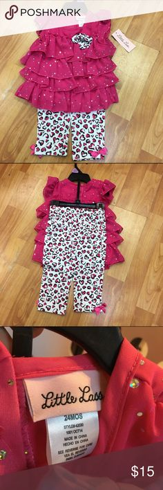 NEW NWT Little Lass Pink White Sparkly Outfit 24 m NEW NWT Little Lass Pink White Sparkly Outfit 18-24 mo  Size is 24 mo but should fit like 18-24.  Pants are knit with an elastic waist.  Heart pattern.  Top buttons in the back and has a bow on the front to match the pants.  #new #nwt #outfit #set #bundle #bundles #polkahearts #hearts #heart #pink #white #black #ruffles #layered #sparkly #sparkle Little Lass Matching Sets