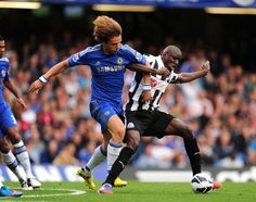 David Luiz and Demba Ba battle for the ball. Demba Ba played his first game for Chelsea January 5, 2013  ***
