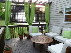 LOVE the trellis & curtains outdoors, privacy & a homey feeling!