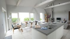 Dining with a view over Sennen Cove at luxury self-catering beach house Chy-an-Gargo in Sennen, Cornwall #sennen #white #dining #openplan #luxury #boutique #cornwall