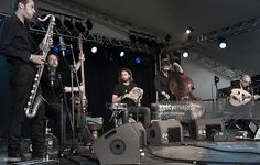 L'Hijaz'Car perform at the Womad festival at Charlton Park in Wiltshire, July 2015. From left to right, they are Jean Louis Marchand on bass clarinet, Nicolas Beck on tarhu, Etienne Gruel on percussion, Vincent Posty on double bass and Grégory Dargent on oud.